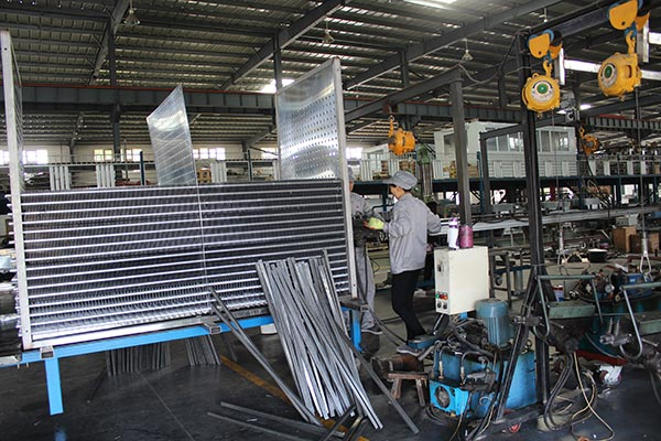 Workers Are Operate Machine To Produce Evaporator